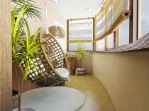 Подвесное плетеное кресло в интерьере большой лоджии