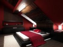 Сочетание красных стен и черной мебели в спальне на мансарде